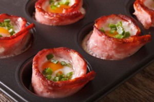 © Sergii Koval | Dreamstime.com - Hot eggs wrapped in bacon close up in baking dish. Horizontal