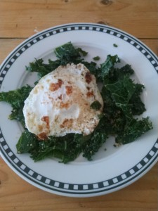 Fried egg on top of garlicky sauteed kale